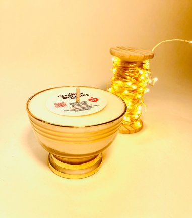 Small glass candle with golden border